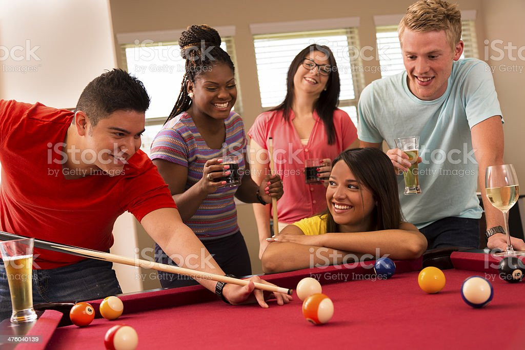 Games: Friends playing pool together. Having round of drinks. royalty-free stock photo