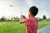 Boy with remote control plane