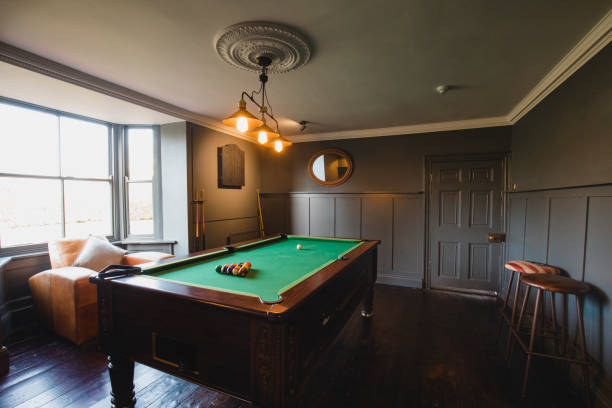 games room with a pool table - cue ball stock pictures, royalty-free photos & images