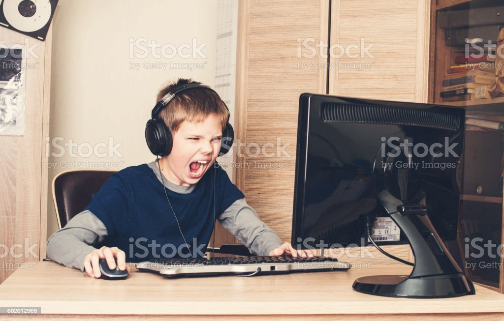 Gaming, entertainment, technology, let's play concept. Angry screaming pre teen stock photo