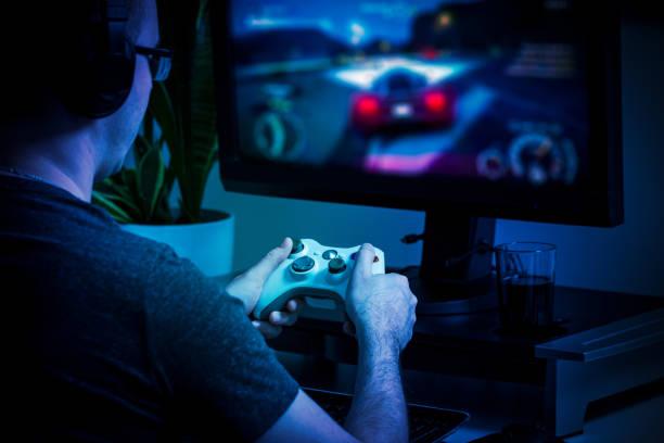 gaming game play video on tv or monitor. gamer concept. - man joystick imagens e fotografias de stock