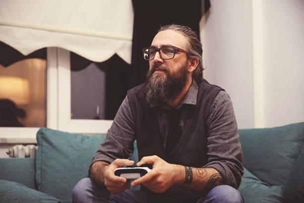 gaming game play video on tv or monitor. gamer concept - man joystick imagens e fotografias de stock