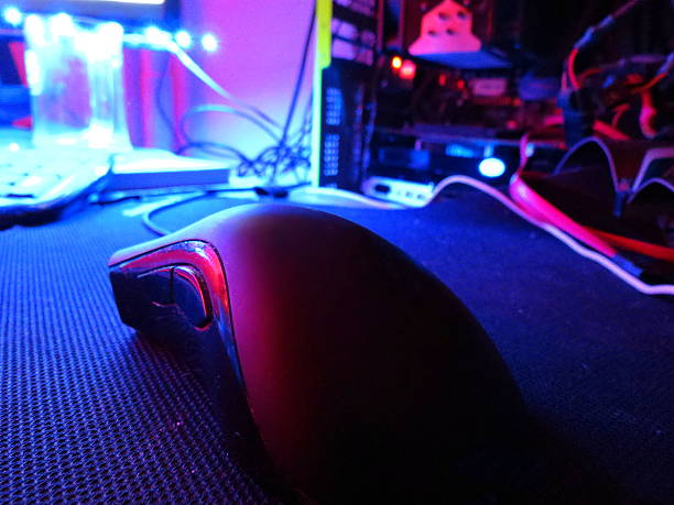 gaming mouse on the mat stock photo