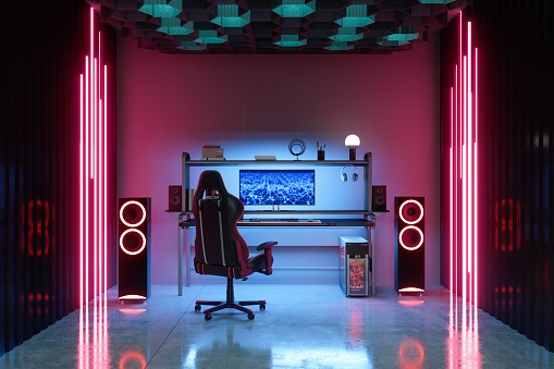 Gaming Room At Night With Neon Light. Gaming Chair And Speakers In The Room.