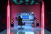 istock Gaming Room At Night With Neon Light. Gaming Chair And Speakers In The Room. 1312949197