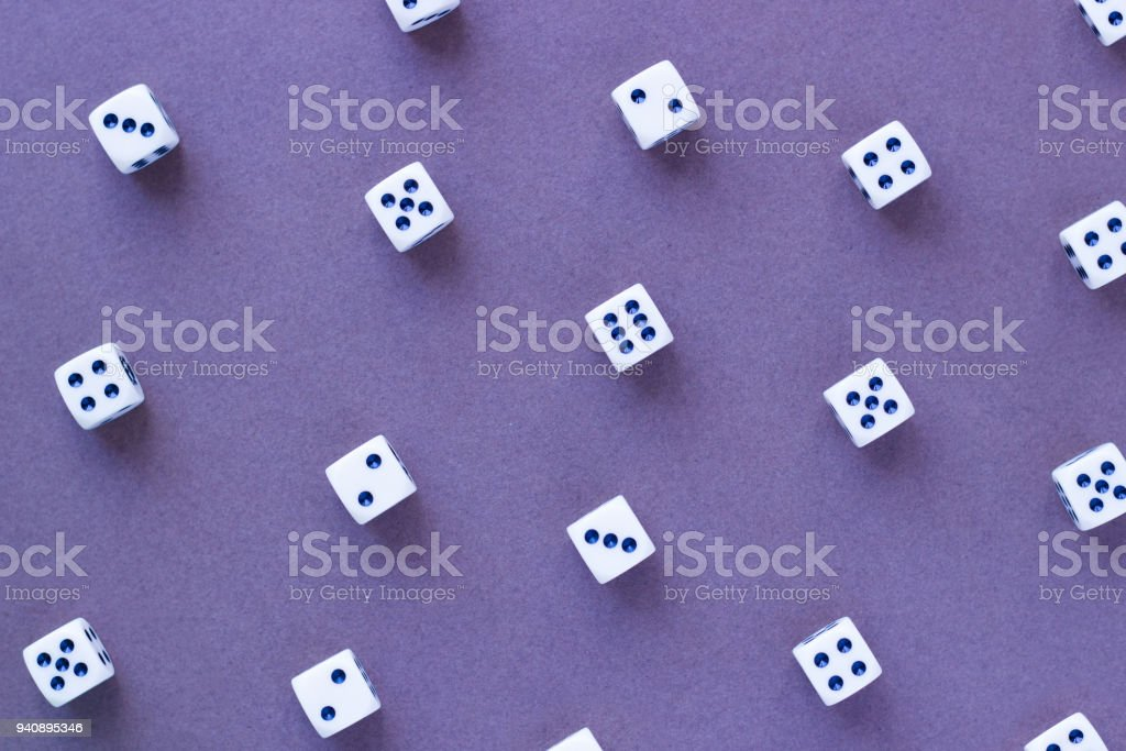 gaming white dice pattern on purple background in flat lay style picture id940895346