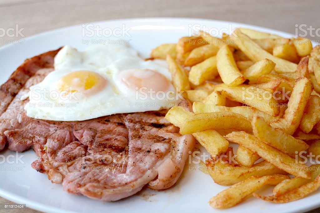 Gammon, egg and chips stock photo