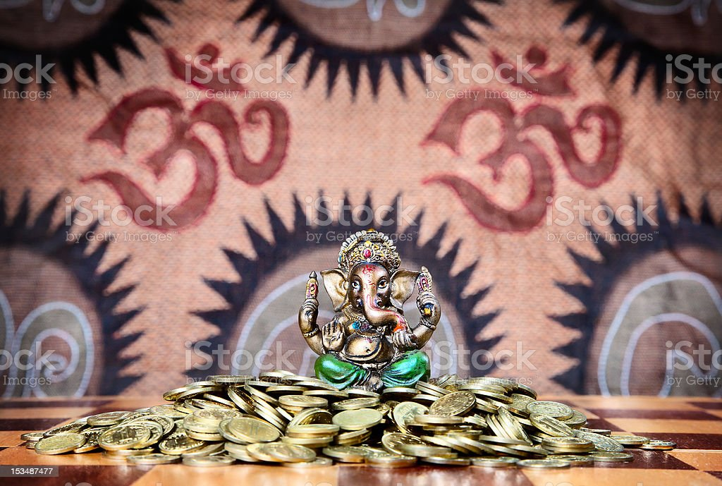 Ganesh on heap of coins royalty-free stock photo