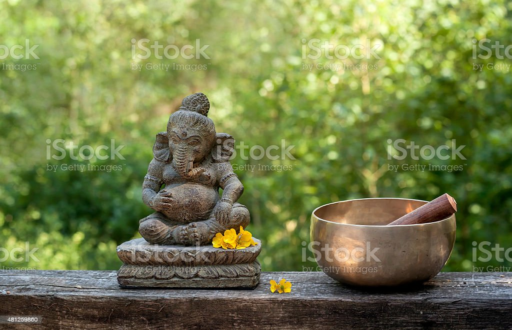 ganesha and tibetan bowl stock photo