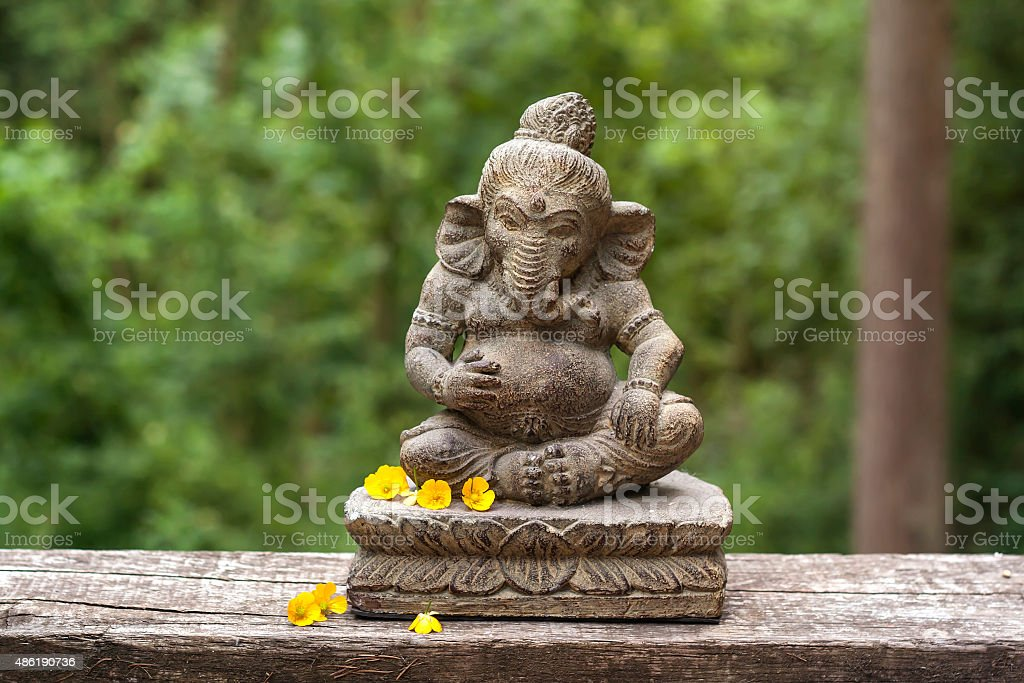 Ganesha with yellow flowers stock photo