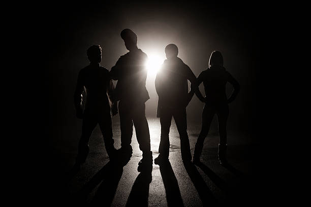 Gang in the shadows stock photo