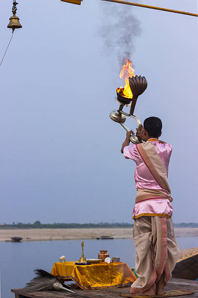 Ganga Aarti Ceremony, Varanasi, India Varanasi, Uttar Pradesh State, India - July 04, 2014: Hindu priest conducts religious Ganga Aarti ritual (puja) at Dashashwamedh Ghat, Varanasi, India. dashashwamedh ghat stock pictures, royalty-free photos & images