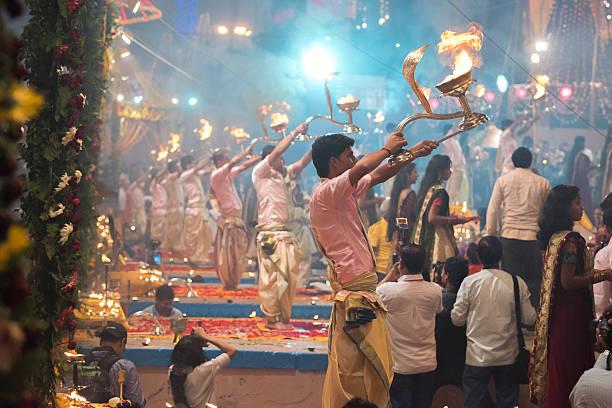 Ganga Aarti, Dev Deepawali Festival, Varanasi, India Varanasi, Uttar Pradesh State, India - November 06, 2014: Hindu priests conducts religious Ganga Aarti ritual (puja) on Dev Deepawali Festival celebrated at Dashashwamedh Ghat, Varanasi, India. dashashwamedh ghat stock pictures, royalty-free photos & images