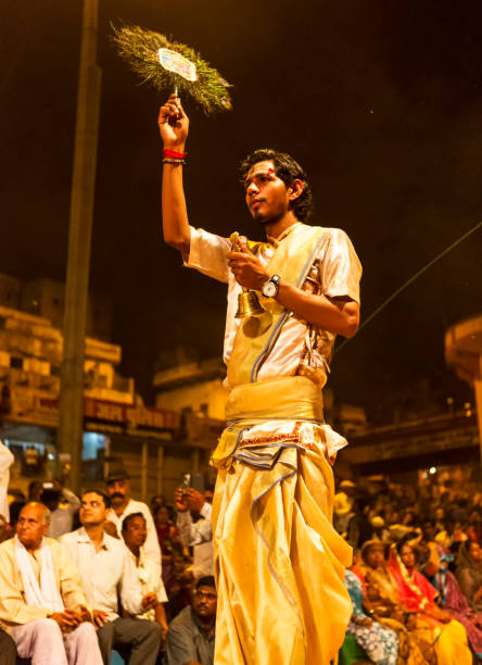 ganga aarti in banaras unknown priest performing ganga aarti in banaras on the banks of ganga on 21 march 2015 dashashwamedh ghat stock pictures, royalty-free photos & images