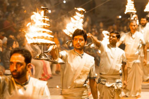 ganga aarti of varanasi - religious celebration stock photos and pictures