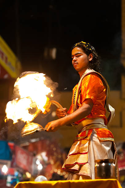 Ganga Aarti Varanasi, India - March 3, 2013: Hindu priest performing religious Ganga Aarti ritual at Dashashwamedh Ghat dashashwamedh ghat stock pictures, royalty-free photos & images