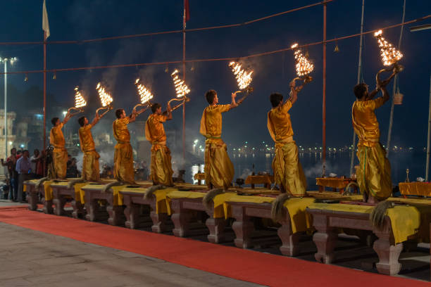 Ganga Aarti puja October 14,2017. Varanasi,Uttar Pradesh,India.Young Priests performing Early morning Ganga Aarti puja celebration at Varanasi ghat before Sunrise. dashashwamedh ghat stock pictures, royalty-free photos & images