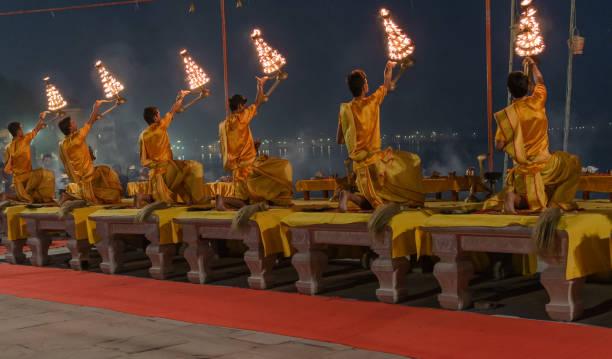 Ganga Aarti puja October 14,2017. Varanasi,Uttar Pradesh,India.Young Priests performing  Ganga Aarti puja at  Assi Ghat before Sunrise. dashashwamedh ghat stock pictures, royalty-free photos & images