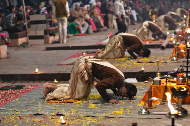 Ganga Maha Aarti Ceremony in Varanasi, India Varanasi, India - January 3, 2016: Indian Brahmins conducts religious Ganga Maha Aarti ceremony (fire puja) at Dashashwamedh Ghat dashashwamedh ghat stock pictures, royalty-free photos & images