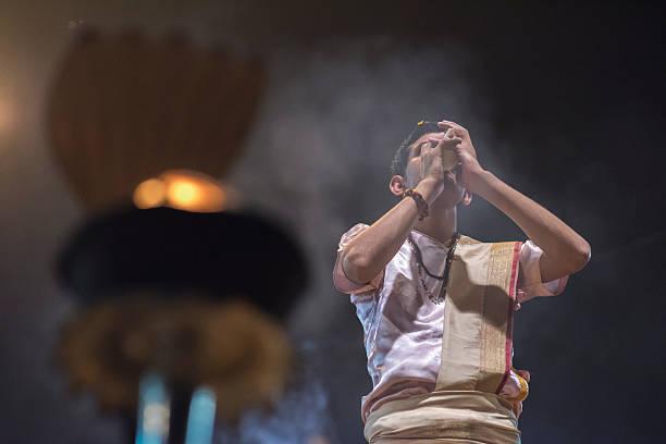 Ganga Maha Aarti Ceremony, Varanasi, India Varanasi, Uttar Pradesh State, India - November 05, 2014: Hindu priest conducts religious Ganga Aarti ritual (puja) at Dashashwamedh Ghat, Varanasi, India dashashwamedh ghat stock pictures, royalty-free photos & images