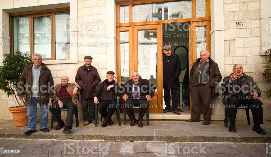 Gangi, Sicily: Senior Men Socialize In Front of 'Circolo' Club stock photo