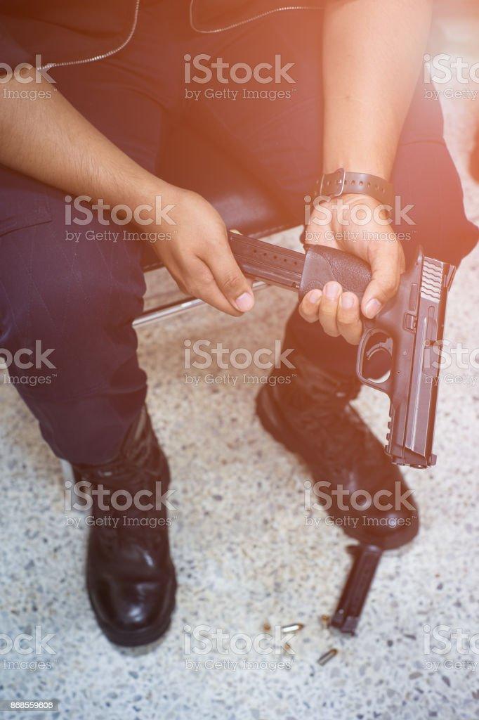Gangster loading bullets handgun stock photo