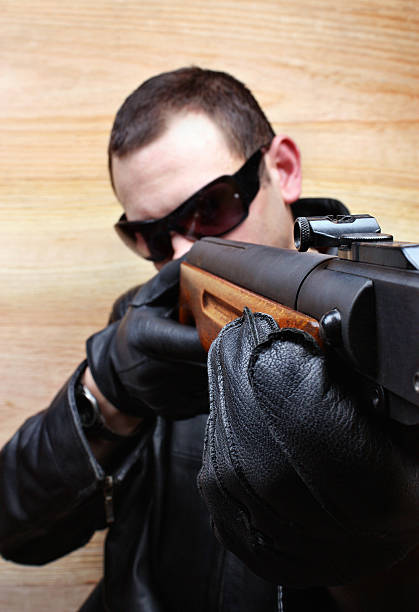 Gangster mafia criminal shoots a gun stock photo