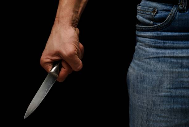 Gangster Knife in hand ready to attack on the black background cutthroat stock pictures, royalty-free photos & images