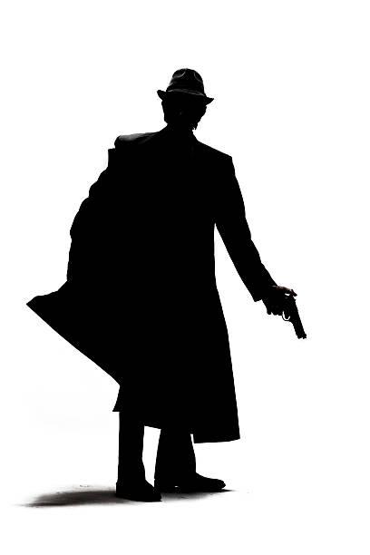 Gangster Pulling gun from holster stock photo