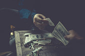 istock Gangster sell heroin to drug addicts. 1259107989