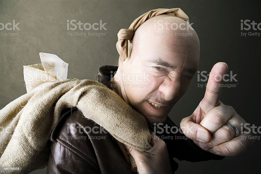 Gangster threating for silence after robbery stock photo