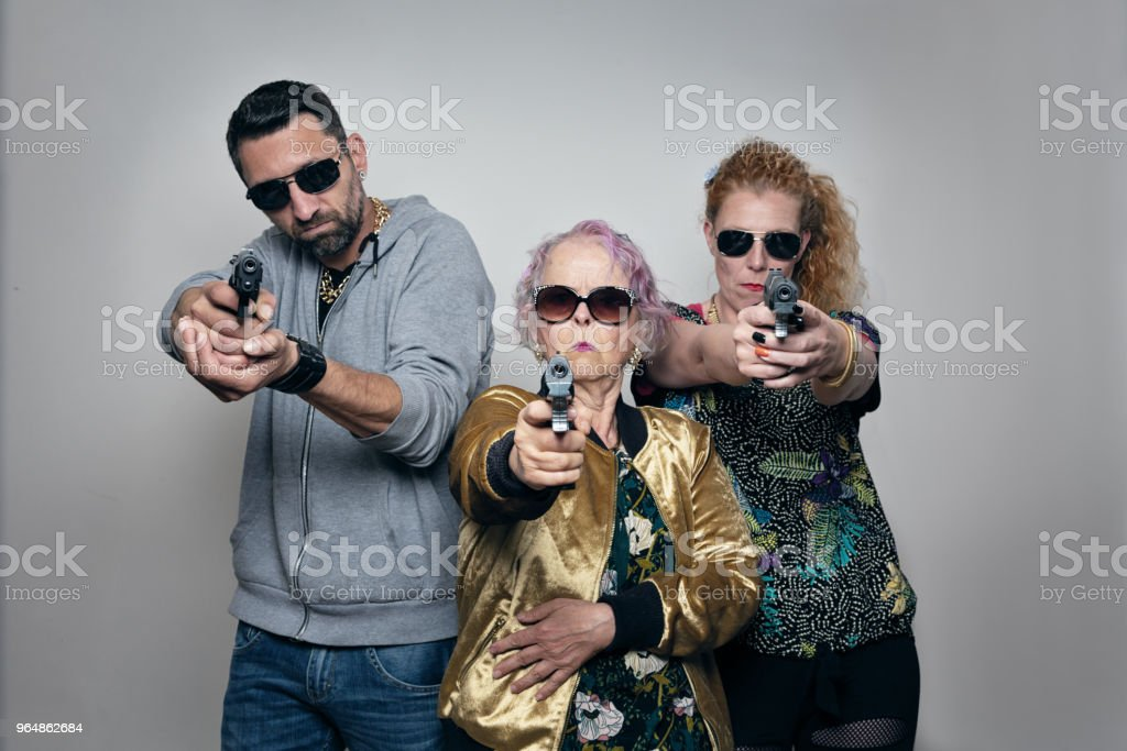 gangster trio: mother, adult son and his fiancée royalty-free stock photo