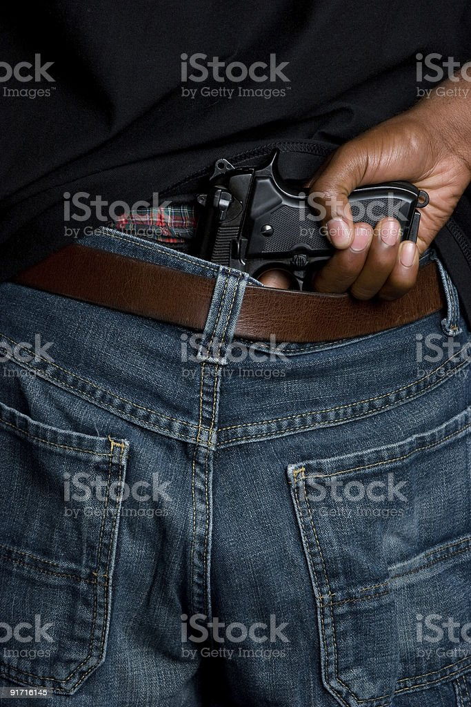 Gangster with gun in belt stock photo