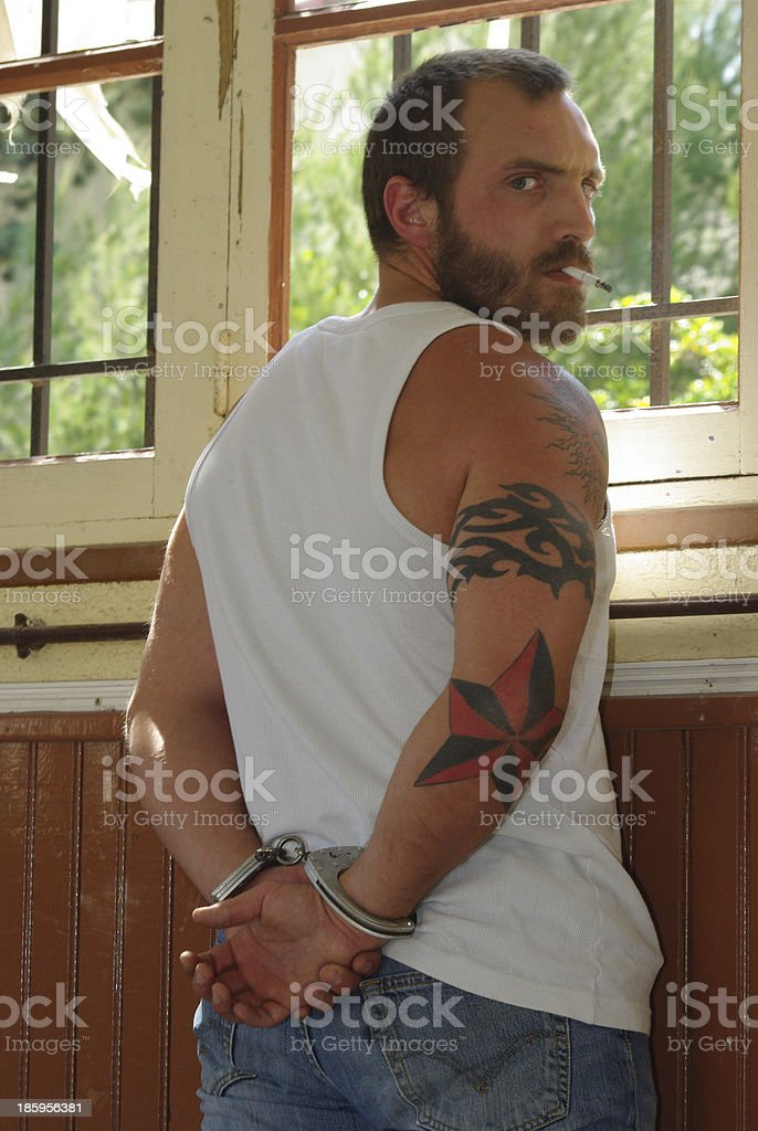 Gangster with handcuffs royalty-free stock photo