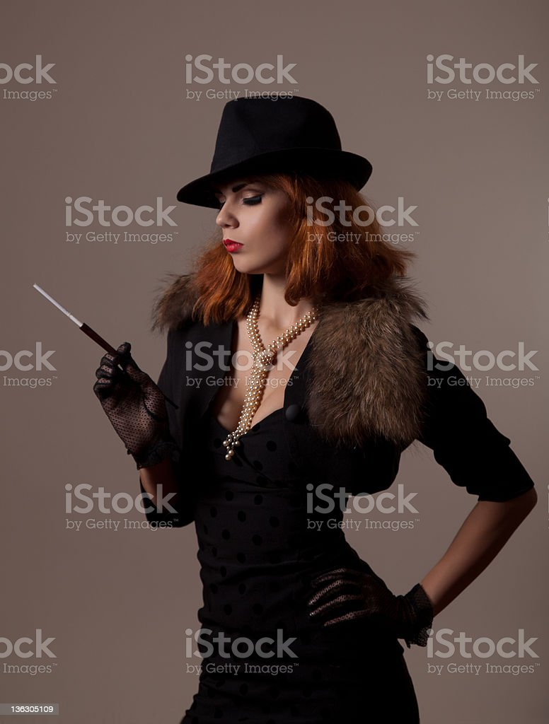 Gangster woman in fedora hat stock photo