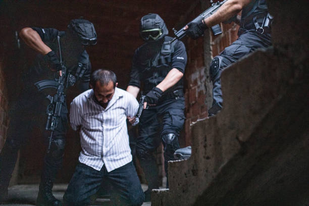 Gangsters Arrest Special forces SWAT in action, making an arrest of a gangster counter terrorism stock pictures, royalty-free photos & images