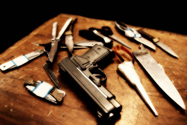 Gangsters weapons of gun, blade and scisors stock photo