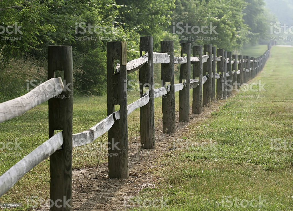 Gap in the fence royalty-free stock photo