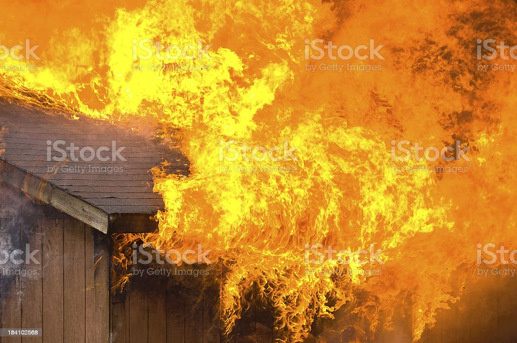 Garage and House on Fire stock photo