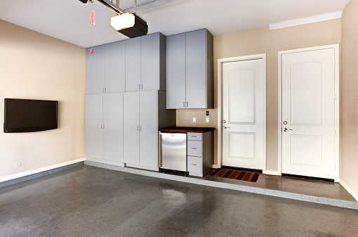A photo of custom cabinets built in a garage.