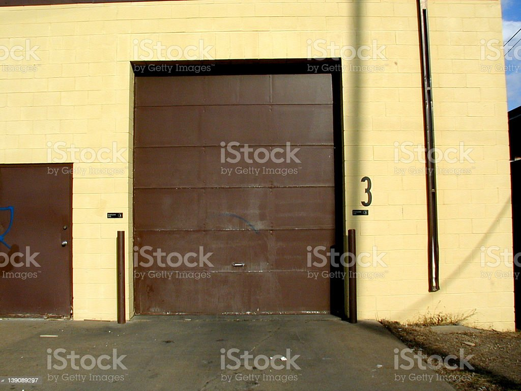 garage door and the number 3 royalty-free stock photo