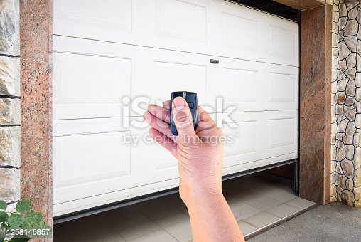 Hand use remote controller for closing and opening garage door