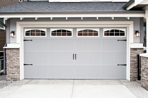 it's a garage door / nothing less and nothing more / than a garage door
