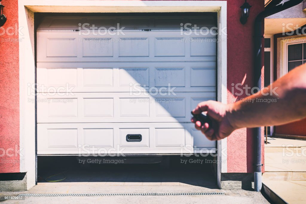 garage door pvc with remote controller stock photo