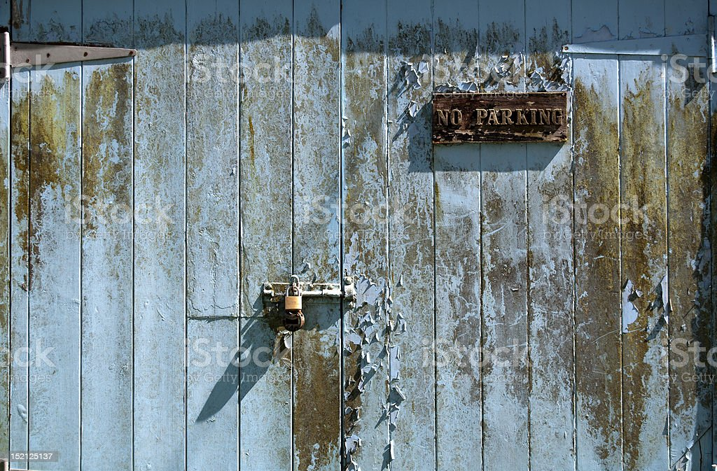 Garage door with no parking sign royalty-free stock photo