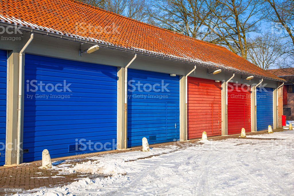 Garage Doors blue and red in Snow stock photo