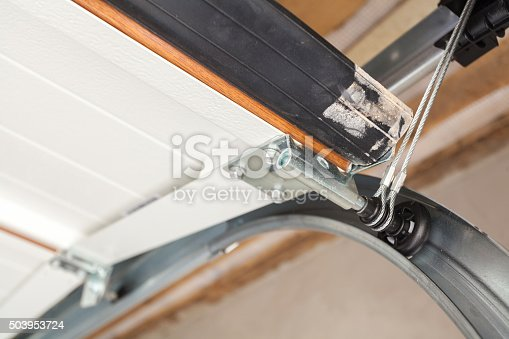 istock Garage doors installation. Close-up of lifting system in metal profil 503953724