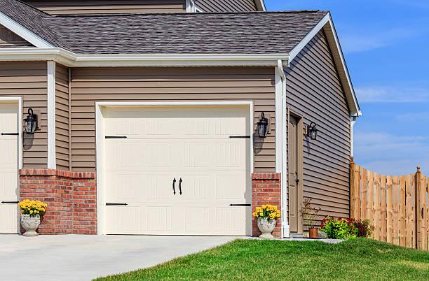 Garage Door,Vinyl Siding,Roof,Fence stock photo