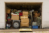 Garage full and stuffed with old stuff and open in good weather for airing
