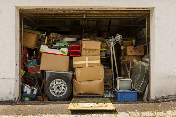 Garage full and stuffed with old stuff and open in good weather for airing Garage full and stuffed with old stuff and open in good weather for airing full stock pictures, royalty-free photos & images
